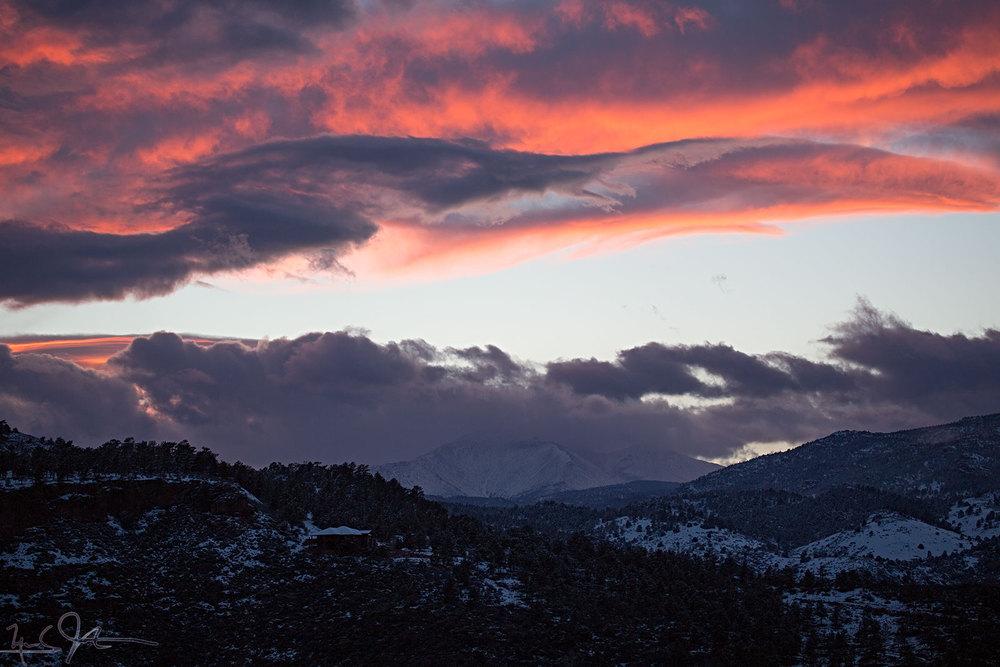 Blue skies appear over Mt. Meeker and Long's Peak.