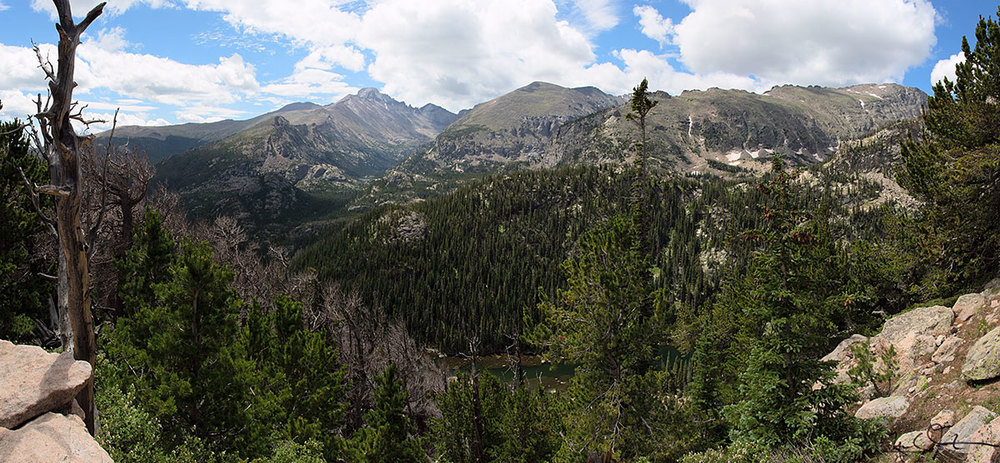 Long's Peak and Glacier Gorge in the distance, and a glimpse of Dream Lake below, from the Flattop Mountain Trail.