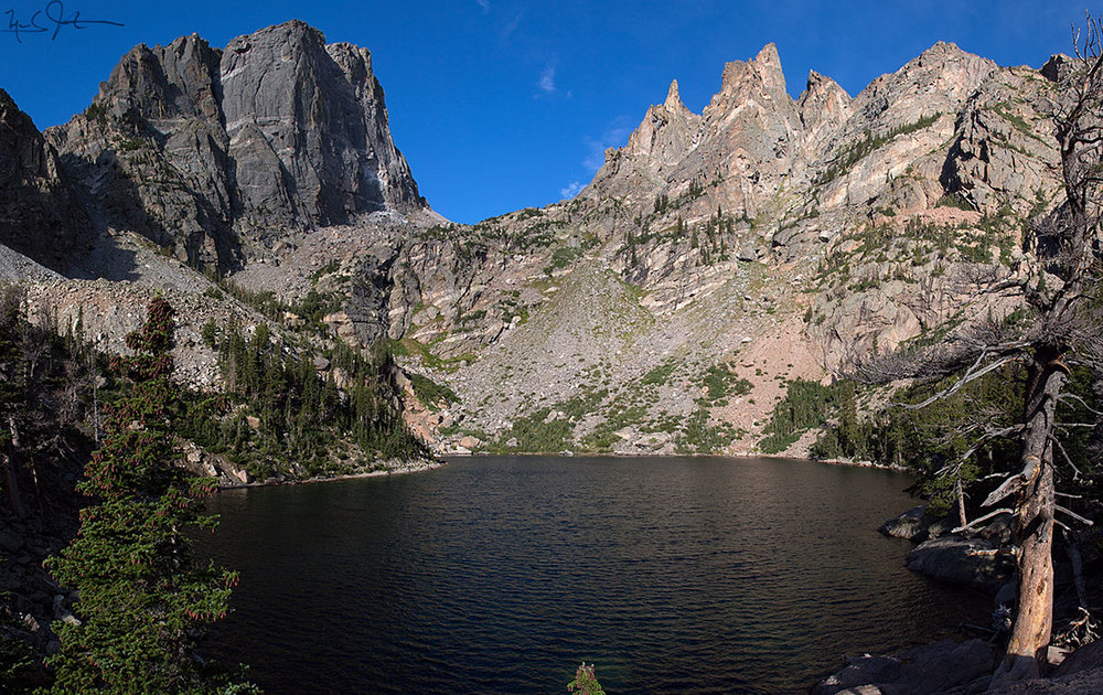 Emerald Lake, with Hallet Peak and rocky spires rising above Tyndall Gorge.