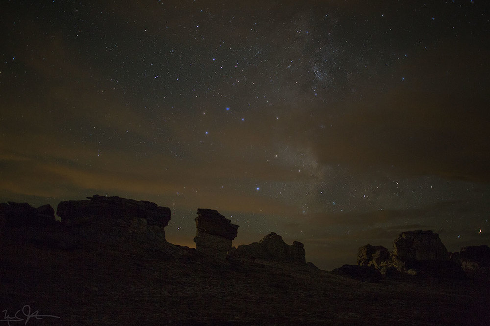 The Milky Way behind mushroom rocks.