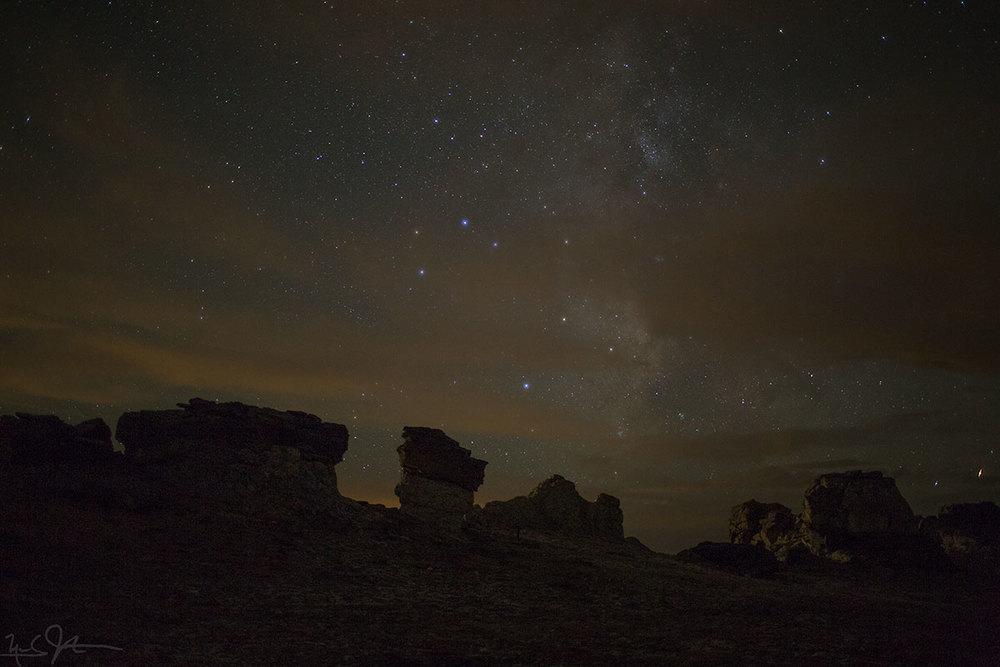 The Milky Way behind mushroom rocks.