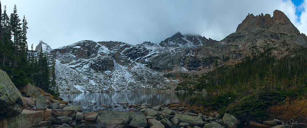 Black Lake [elev. 10,620 ft] under an overcast sky.  The mountain at right is Chiefs Head Peak - the chief is reclining with his nose at the right edge and chin a bit to the left.