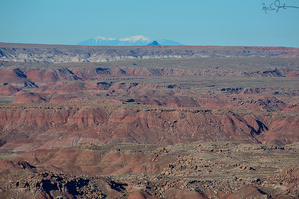 Looking west over part of the Painted Desert, with the San Francisco Peaks that lie just north of Flagstaff, AZ on the horizon - about 100 miles away.