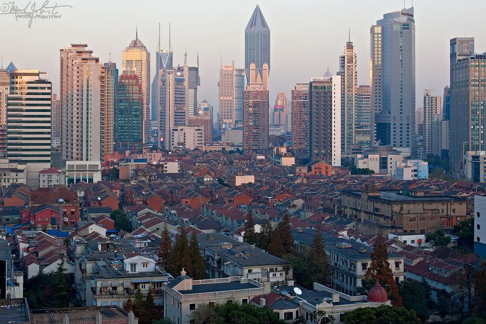 Old neighborhood, new skyscrapers, Shanghai, China.