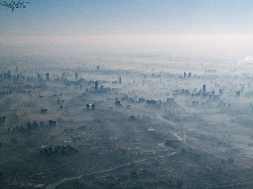 Shanghai stews in its own smog.  From the window of a flight climbing out of Hongqiao International Airport.