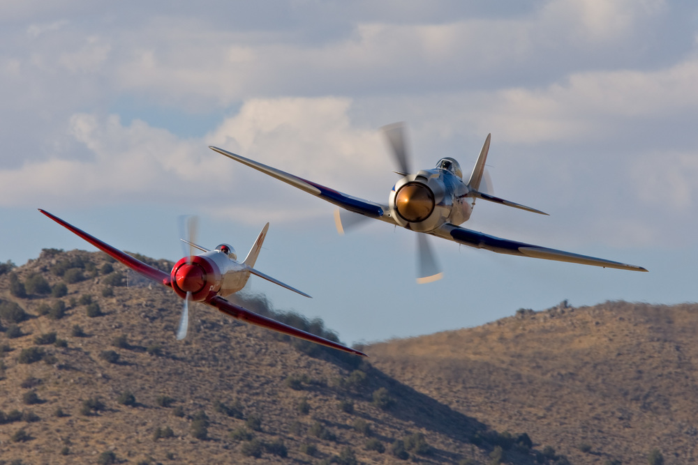Two Hawker Sea Fury aircraft participate in an Unlimited Class race at the National Championship Air Races & Air Show, Reno, Nevada.