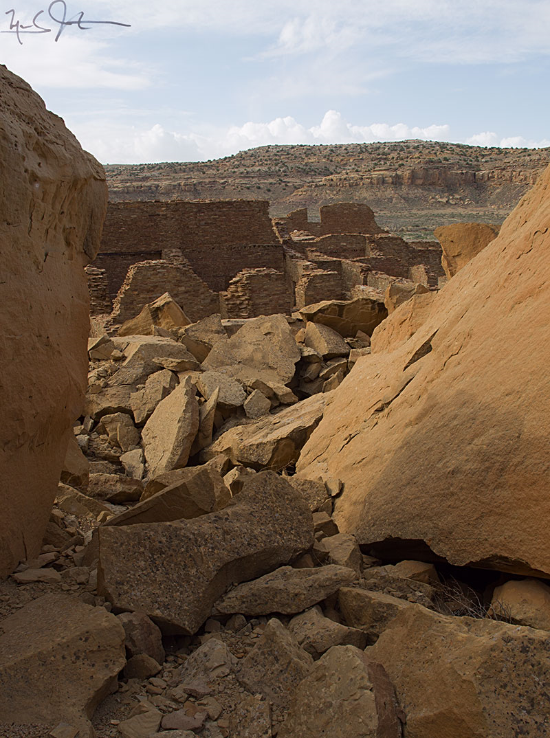 From the midst of the rubble pile that was once threatening rock, looking towards the remaining ruins of Pueblo Bonito.