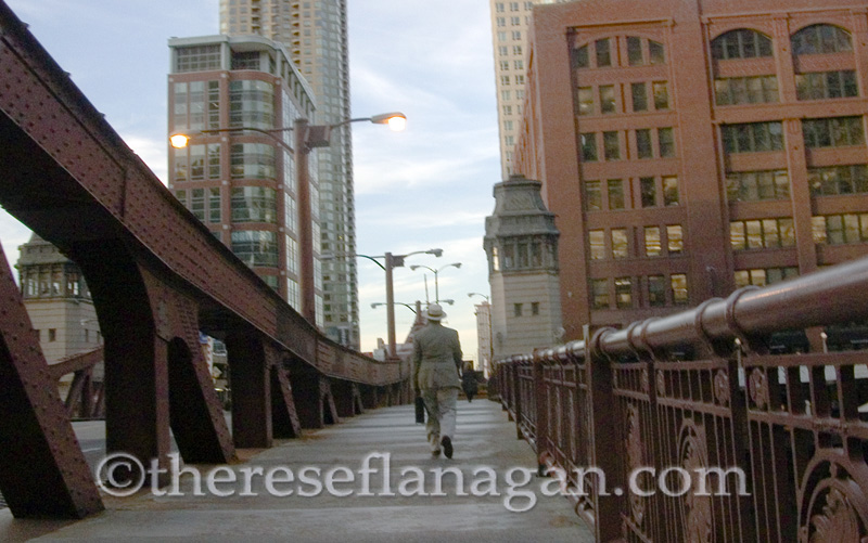 Man Walking on Bridge with Briefcase
