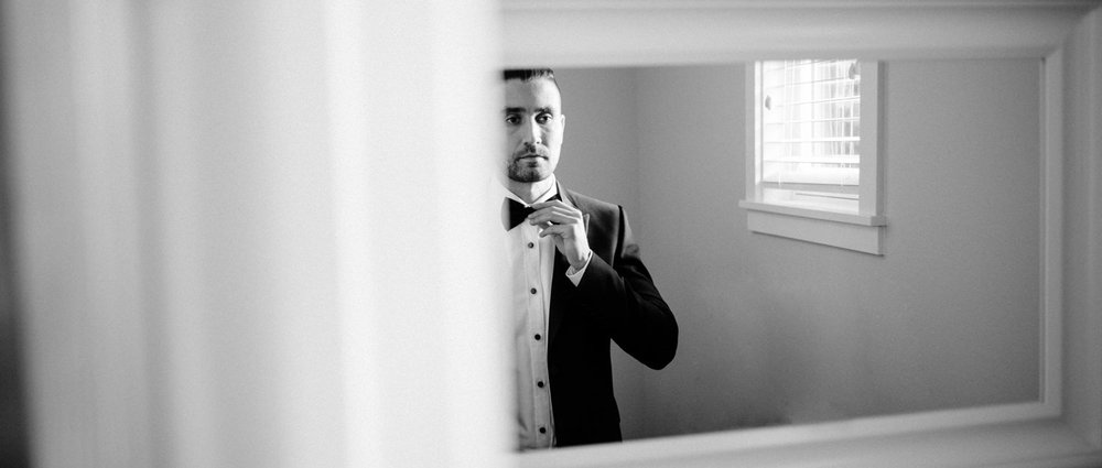 114-dapper-groom-in-tuxedo-and-bow-tie.jpg