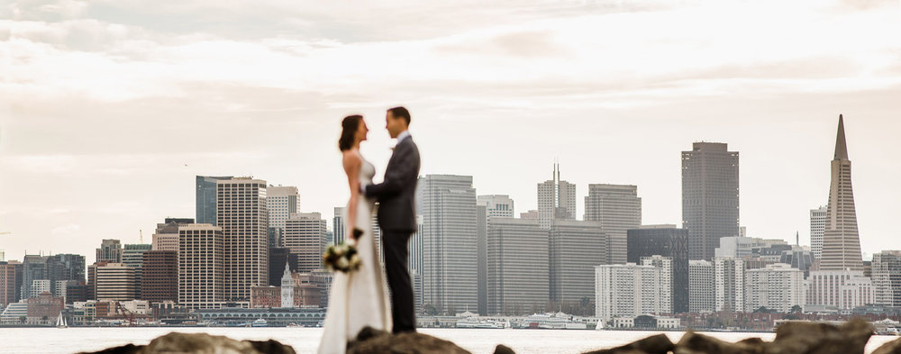 040-panoramic-portrait-of-a-bride-and-groom-overlooking-san-francisco-by-san-francisco-wedding-photographer.jpg