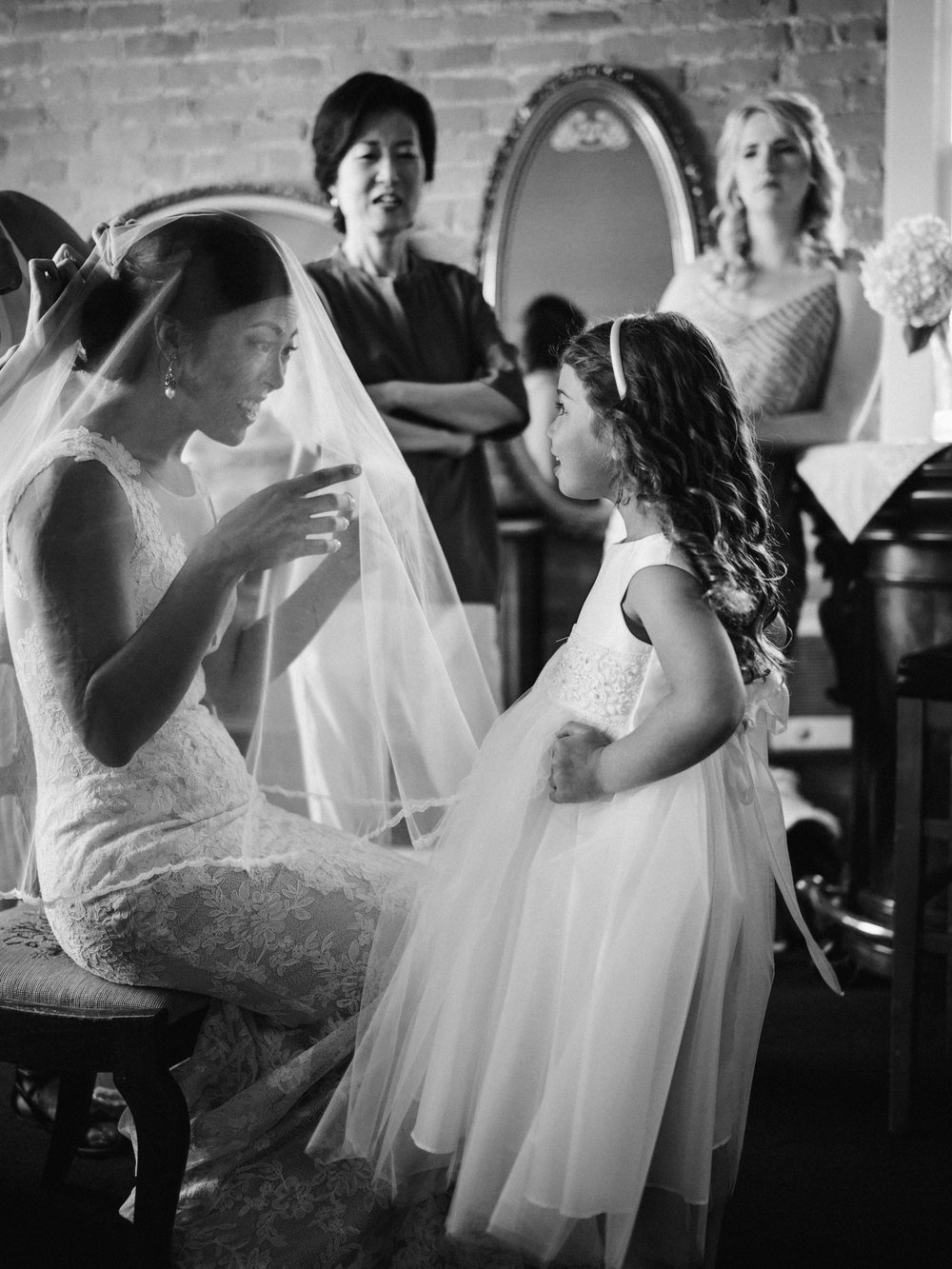 057-bride-and-flower-girl-moment-by-best-seattle-documentary-wedding-photographer-ryan-flynn.jpg