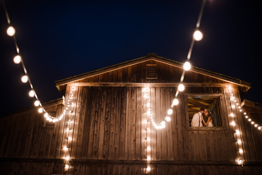 177-backyard-barn-wedding-photo-with-hanging-cafe-lights-by-ryan-flynn.jpg
