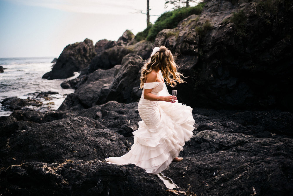 199-pnw-bride-walking-on-a-rocky-beach-by-tofino-wedding-photographer-ryan-flynn.jpg