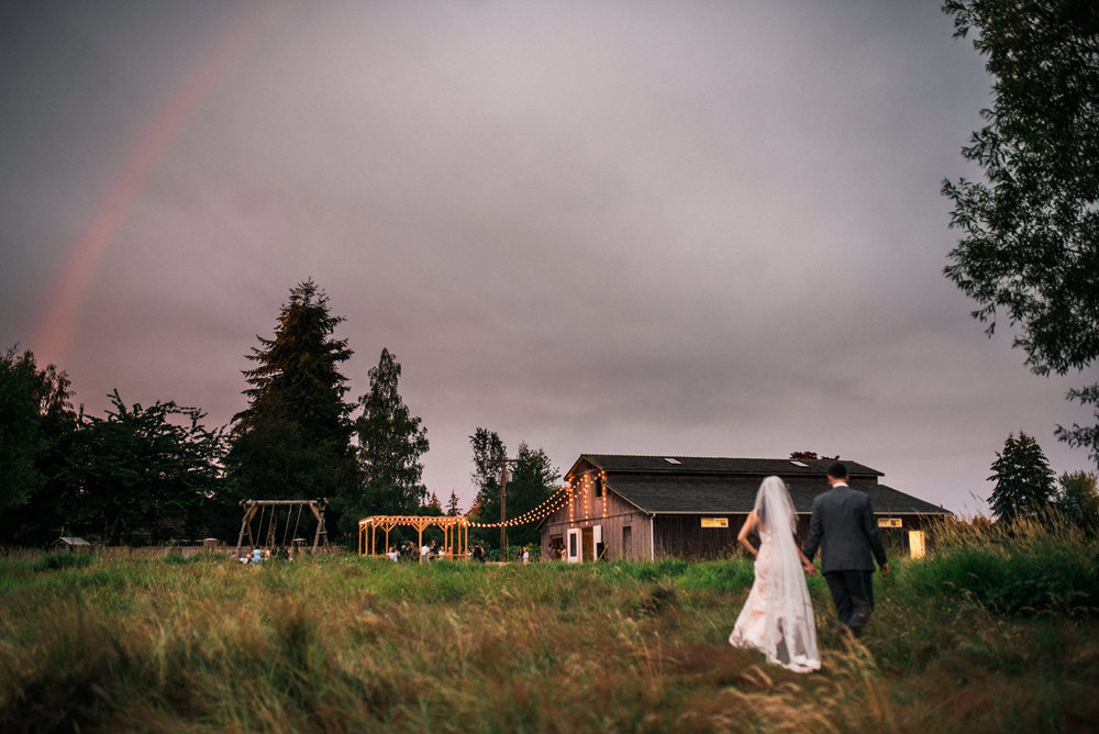 227-rainbow-over-bride-and-groom-during-a-backyard-wedding-on-camano-island.jpg