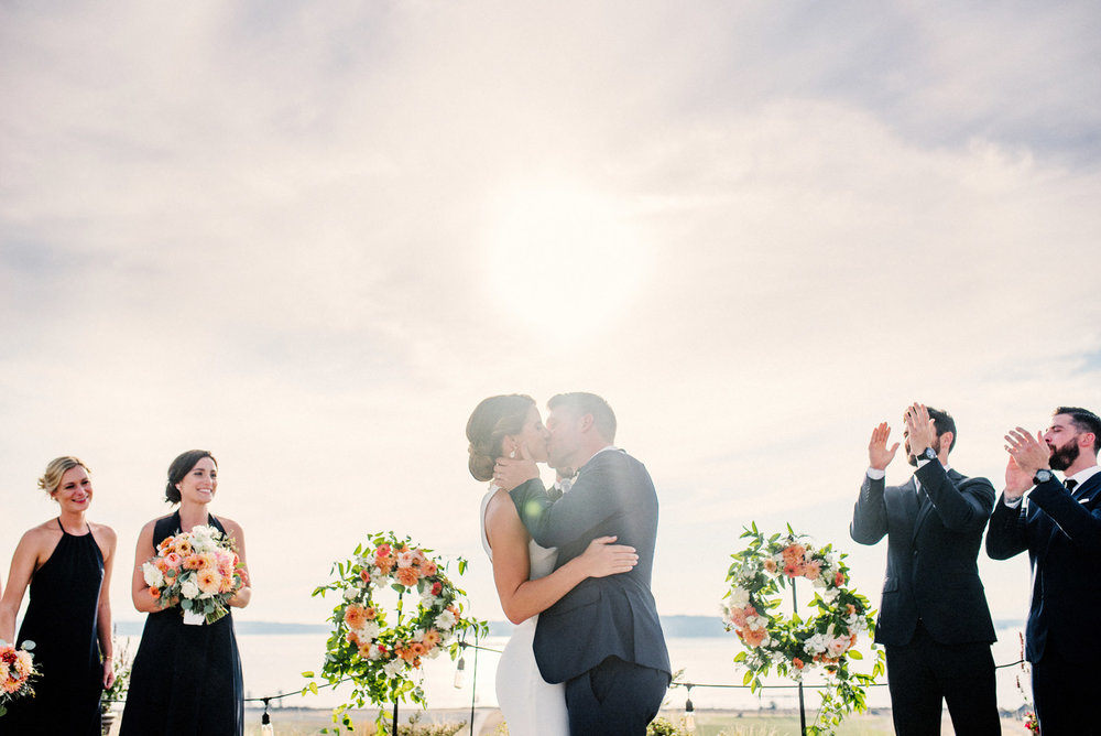 239-celebratory-bride-and-groom-kissing-during-ceremony-at-chambers-bay.jpg
