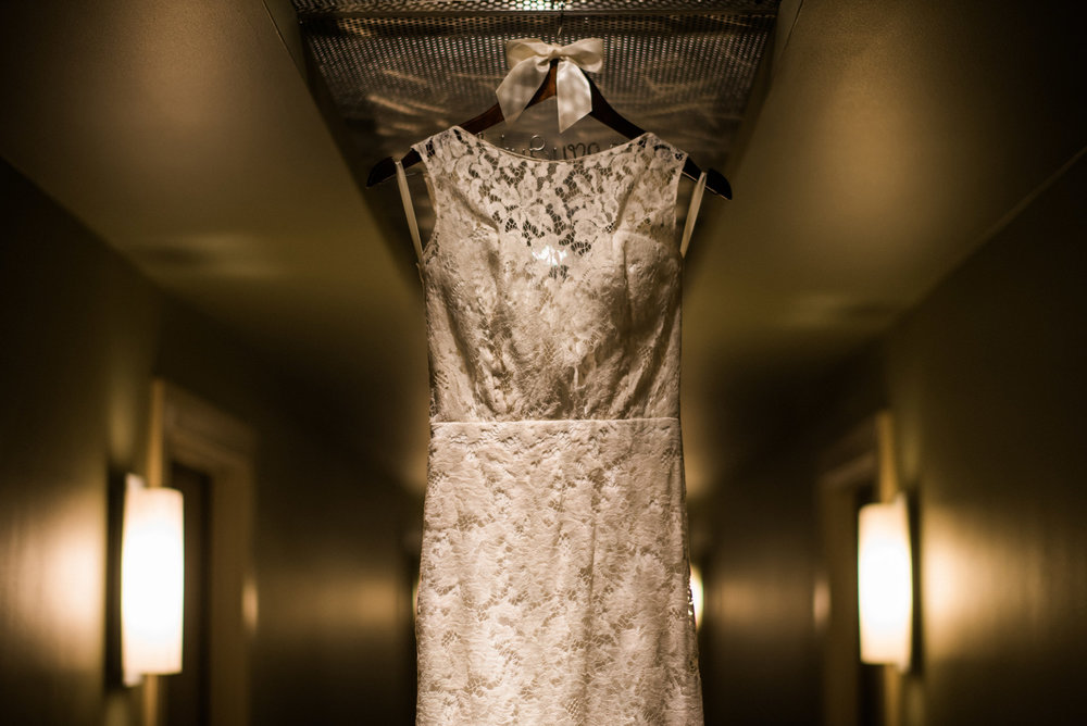 160-sarah-seven-dress-hanging-in-a-hotel.jpg