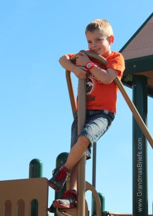 child on park play structure