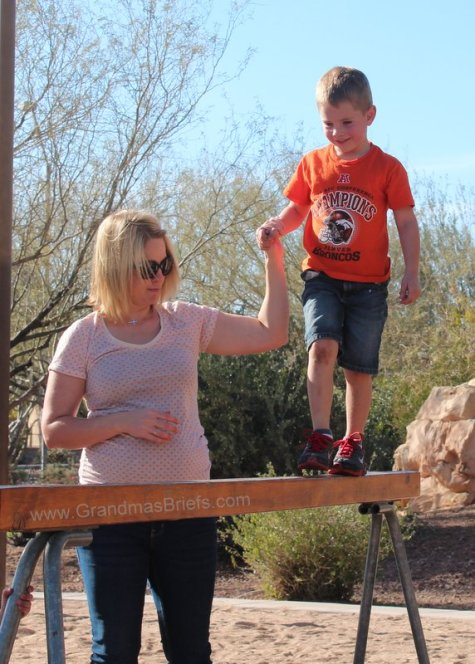 boy on park balance beam