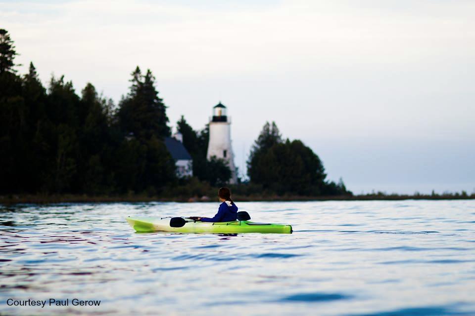 kayaking past lighthouse