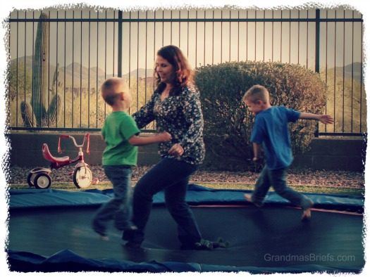 grandma and grandsons on trampoline