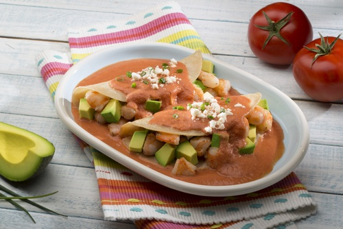 shrimp and avocado enchiladas in creamy red sauce