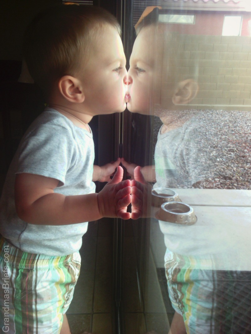 toddler reflection in door
