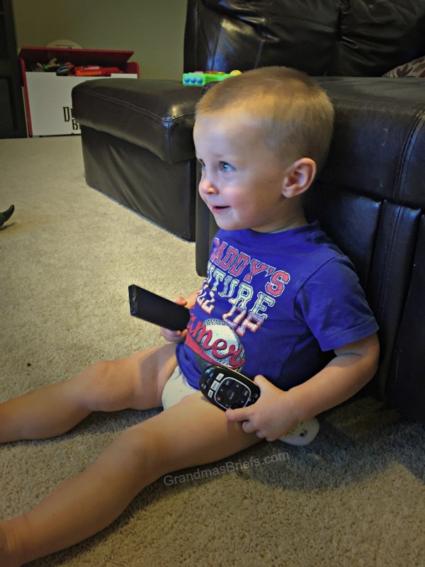 toddler boy with remotes