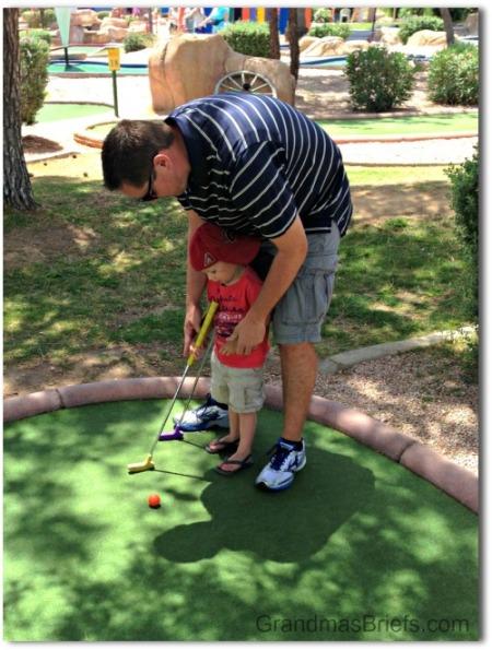 toddler golfing