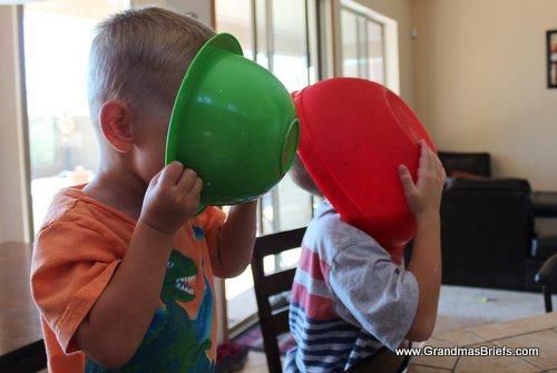 boys licking baking bowls