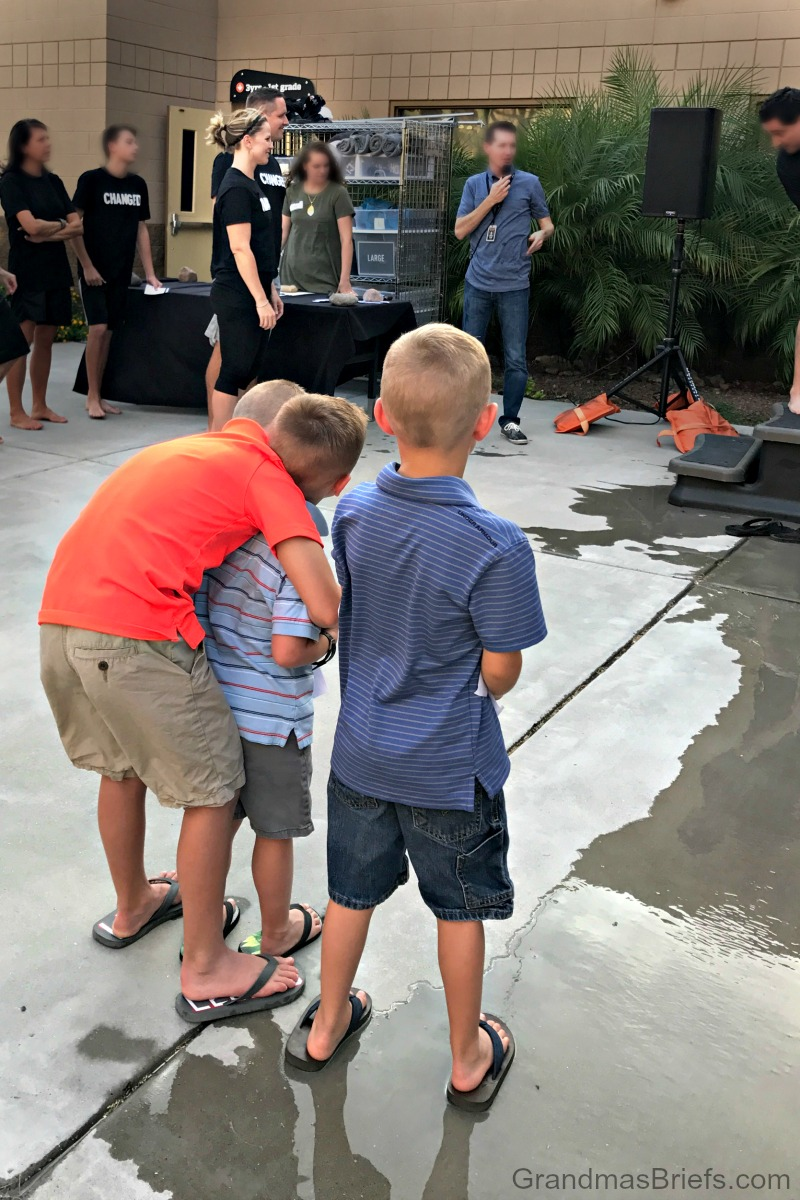 boys watch Mom and Dad get baptized