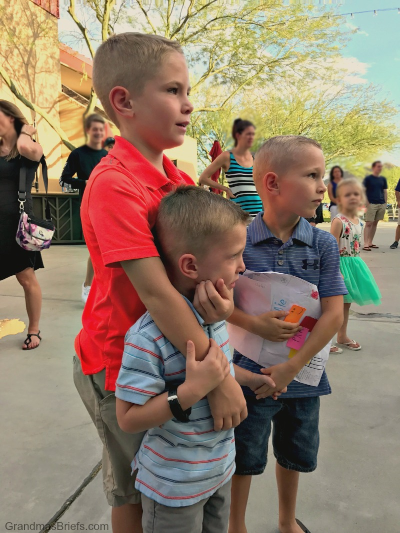 brothers at parents' baptism