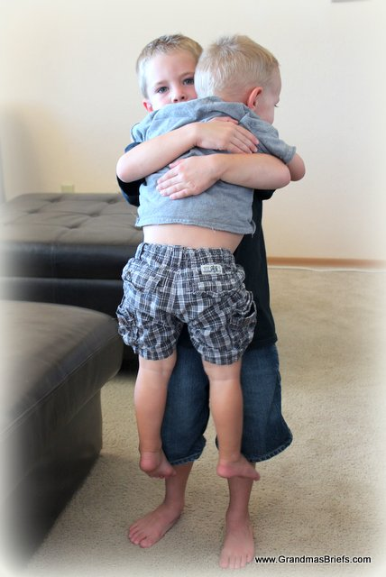 brother carrying toddler brother