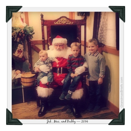 three boys with santa