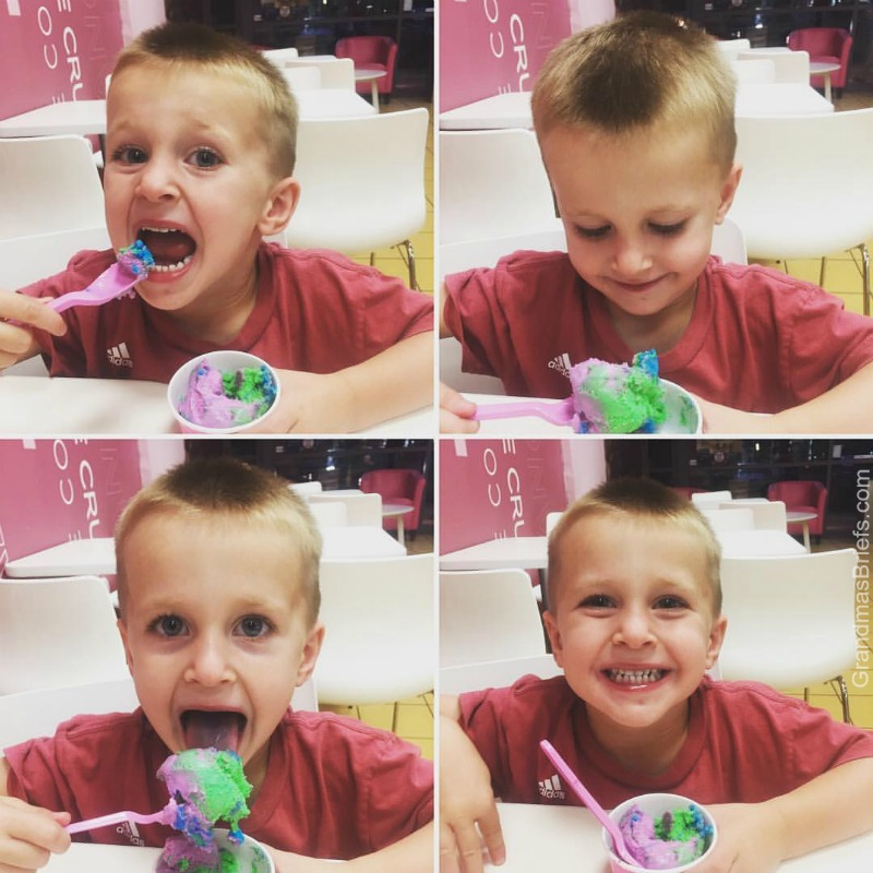 three year old boy eating frozen yogurt