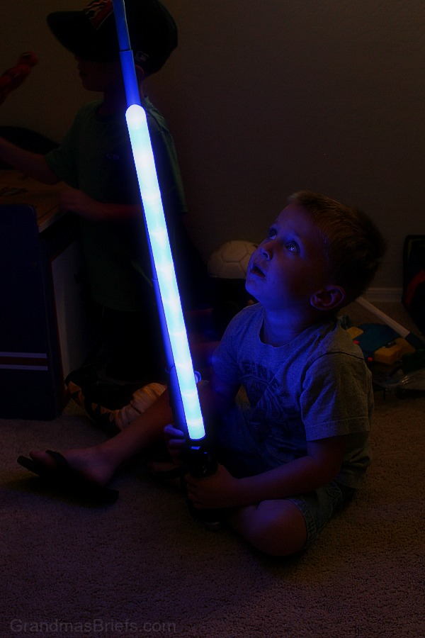 three year old boy with light sword