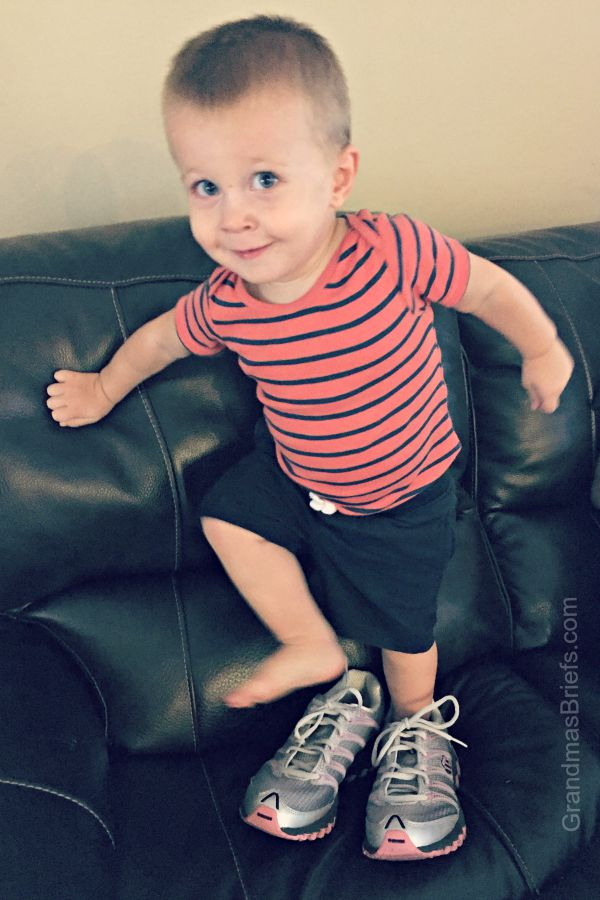 toddler in running shoes