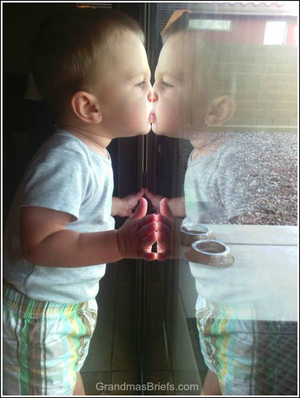 toddler and reflection