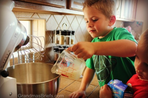 boy pouring ingredients