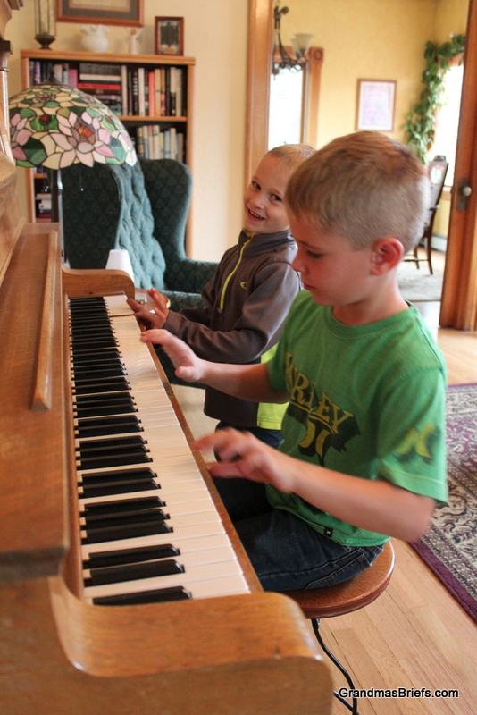 brothers on grandma's piano