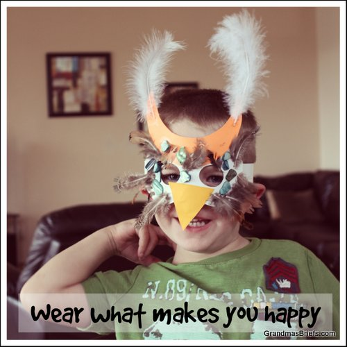 boy wearing owl mask