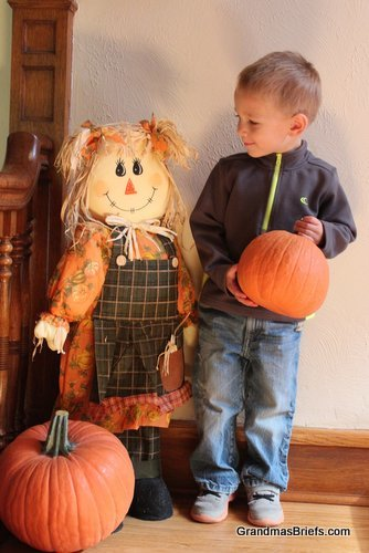 toddler and scarecrow