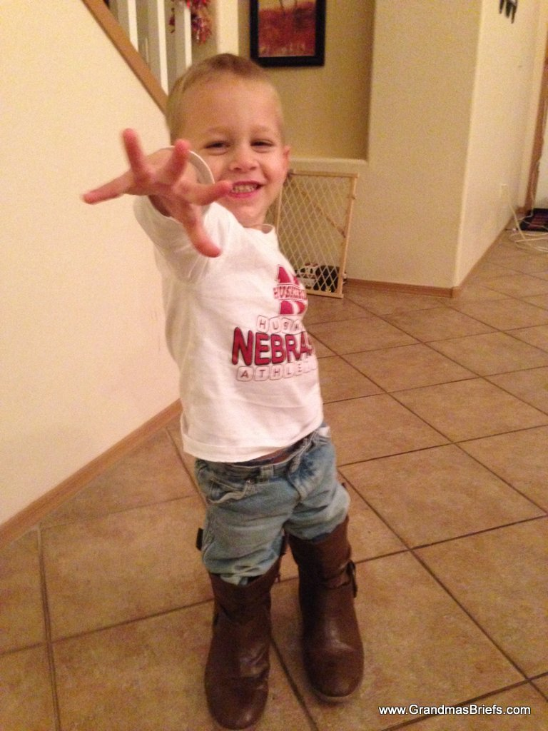 toddler in mom's boots