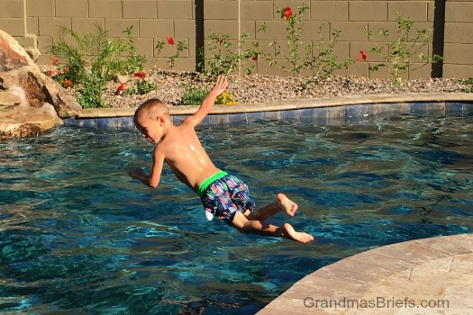 boy dives in pool