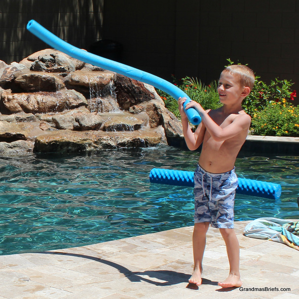 six year old and pool noodle