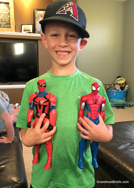 six year old with spider man and spider knight