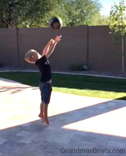 four year old playing basketball