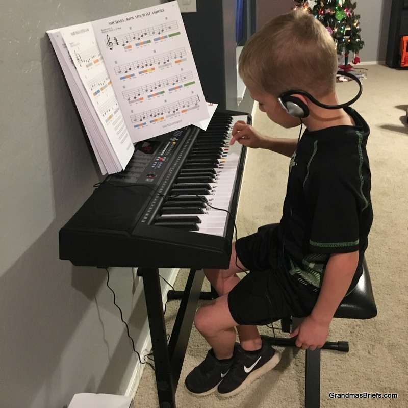 Camden practicing on the new keyboard.