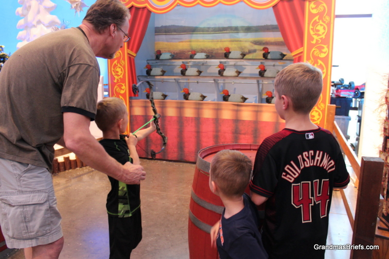 Practicing with PawDad at the Bass Pro Shop shooting gallery
