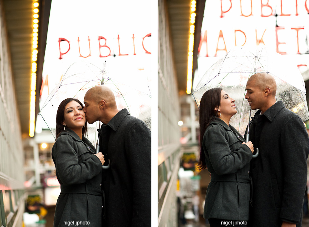 seattle-engagement-photo-umbrella-public-market-sign-pike-place-latino-couple.jpg
