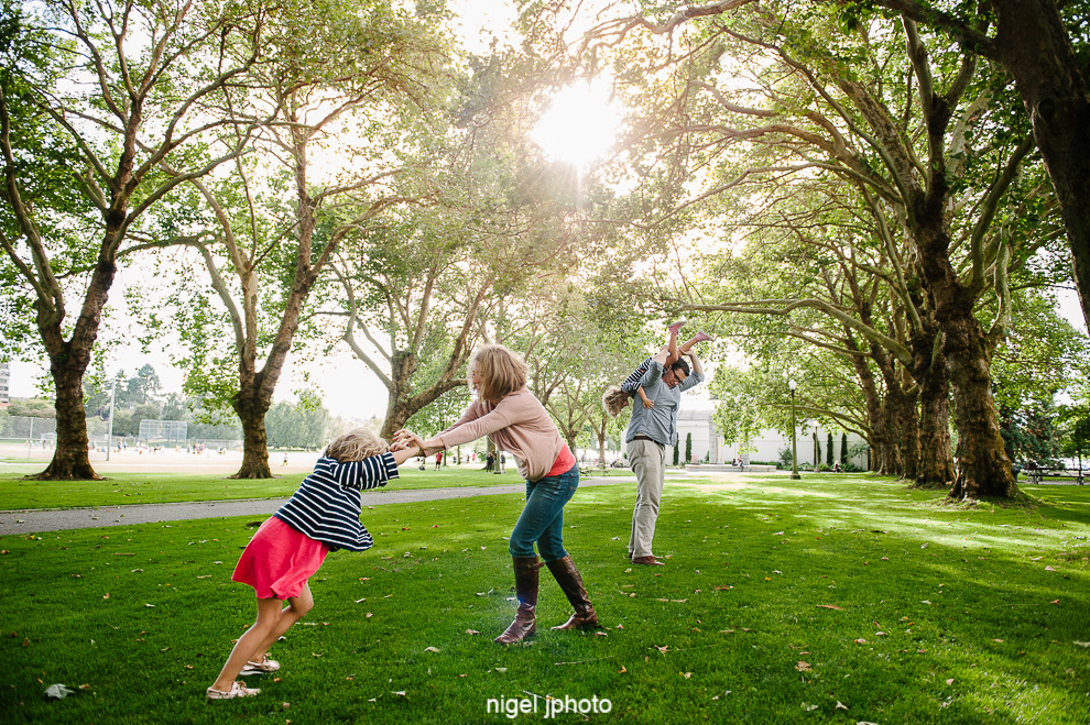 family-photos-seattle-eastside-playing-under-trees.jpg
